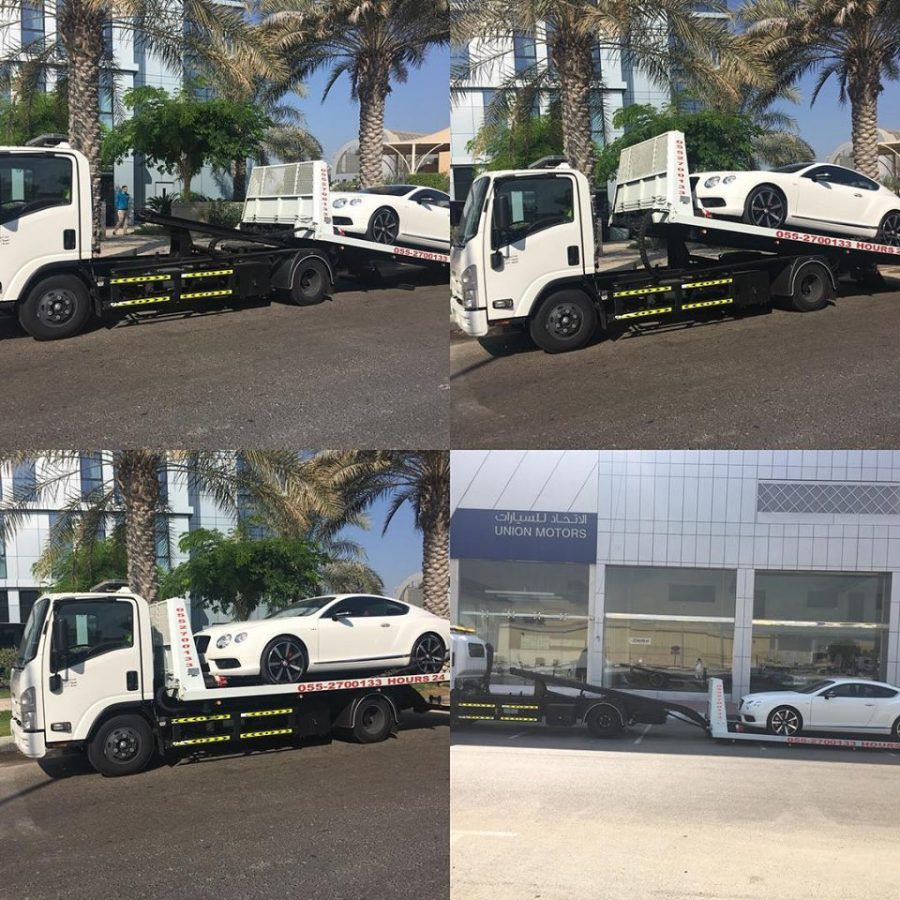 recovery doing for white color vehicle in abu dhabi